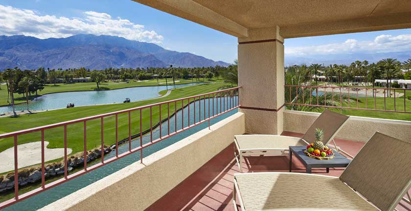 room balcony with a view of the golf course